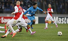 Zenit's Hulk, center, tries to brake through Monaco's defence during the Champions League Group C soccer match between Zenit and Monaco at Petrovsky stadium...