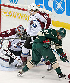 ������ � ������: Colorado Avalanche goalie Semyon Varlamov, left, of Russia, and Nathan MacKinnon join Minnesota Wild's Mikael Granlund, right, of Finland, in a search...