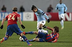 CSKA's Mario Fernandes, right on ground, takes the ball off Manchester City's Sergio Aguero, during the Champions League Group E soccer match between CSKA...