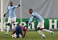 Manchester City's Fernando, right, reacts after fouling CSKA's Zoran Tosic during the Champions League Group E soccer match between CSKA Moscow and Manchester...