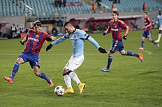 Manchester City's Aleksander Kolarov, center, vies for the ball with CSKA's Vasili Berezutski, left, during the Champions League Group E soccer match between...