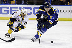 ������ � ������: Nashville Predators' Eric Nystrom, left, and St. Louis Blues' Vladimir Tarasenko, of Russia, chase after a loose puck during the third period of an NHL...