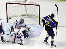 ������ � ������: St. Louis Blues' Jori Lehtera (12), of Finland, skates away after scoring past Washington Capitals goalie Justin Peters and Alex Ovechkin (8), of Russia,...