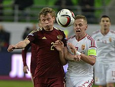 Evgeni Makeev, left, of Russia and Balazs Dzsudzsak of Hungary vie for the ball, during Hungary vs Russia friendly soccer match, at the Groupama Arena,...