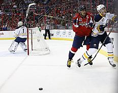 ������ � ������: Washington Capitals left wing Alex Ovechkin (8), from Russia, boards Buffalo Sabres defenseman Tyler Myers (57) in the first period of an NHL hockey game,...