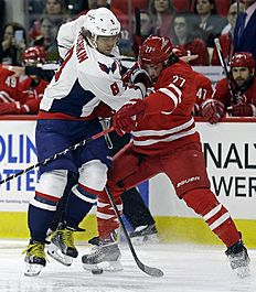 ������ � ������: Carolina Hurricanes' Justin Faulk (27) and Washington Capitals' Alex Ovechkin (8), of Russia, struggle for possession of the puck during the first period...
