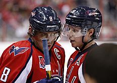 ������ � ������: Washington Capitals left wing Alex Ovechkin (8), from Russia, and Washington Capitals center Nicklas Backstrom (19), from Sweden, talk in the second period...