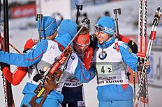 Russia's Dmitry Malyshko, from left, Maxim Tsvetkov,Anton Shipulin and Timofey Lapshin celebrate their victory in the finish area after the men's Biathlon...