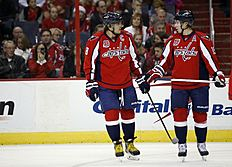 ������ � ������: Washington Capitals left wing Alex Ovechkin (8), from Russia, and Washington Capitals center Nicklas Backstrom (19), from Sweden, talk during a break in...