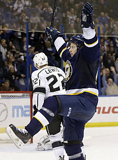������ � ������: St. Louis Blues' Vladimir Tarasenko, of Russia, celebrates after scoring as Los Angeles Kings' Trevor Lewis, left, skates in the background during the...