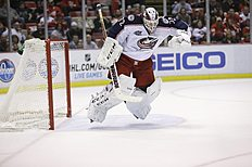 ������ � ������: Columbus Blue Jackets goalie Sergei Bobrovsky of Russia jumps to avoid a shot during the second period of an NHL hockey game against the Detroit Red Wings...