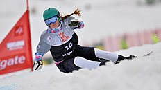 Snowboard (сноуборд): Russia's third placed Alena Zavarzina speeds down the hill during the women's parallel slalom race at the Snowboard World Cup event in Schruns, Austria,...