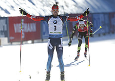 Russia's Anton Shipulin celebrates in the finish area of the men's 15 km mass start competition at the Biathlon World Cup event, in Pokljuka, Slovenia,...