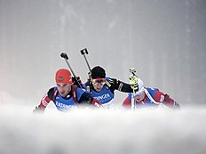 Dmitry Malyshko of Russia, Simon Desthieux of France and Johannes Thingnes Boe of Norway, from left to right, ski during the men's 4x7.5 kilometers relay...