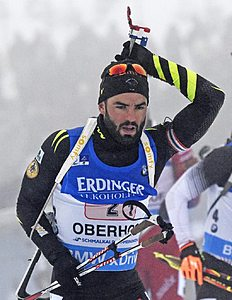 Simon Fourcade of France prepares for shooting during the men's 4x7.5 kilometers relay race at the Biathlon World Cup in Oberhof, central Germany, Thursday,...