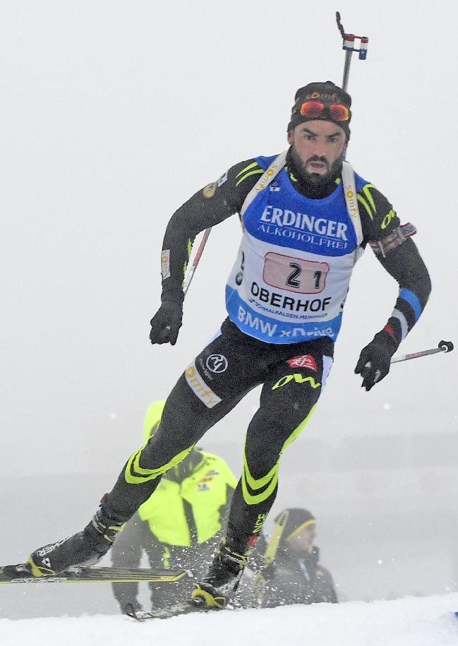 Simon Fourcade of France skis during the men's 4x7.5 kilometers фото (photo)