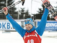 Third placed Timofey Lapshin of Russia celebrates on his way to the podium after the men's 10 kilometers sprint race at the Biathlon World Cup in Oberhof,...