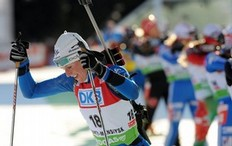 Sandrine Bailly of France races to place second in the women's 12, 5 km mass start event of the biathlon World Cup in the Siberian city of Khanty-Mansiysk on March 27, 2010.