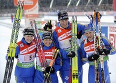 From left: Sweden's Helena Jonsson, Anna Carin Olofsson-Zidek, Bjorn Ferry and Carl Johan Bergman celebrate they third place after the biathlon World Cup mixed relay in the Siberian city of Khanty-Mansiysk on March 28, 2010.