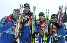 KHANTY-MANSIYSK, RUSSIA - MARCH 28: (L-R) The silver medallists Carl Johan Bergman, Bjoern Ferry, Helena Jonsson and Anna Carin Olofsson-Zidek of Sweden show their medal after the relay mixed in the E.On Ruhrgas IBU Biathlon World Cup on March 28, 2010 in Khanty-Mansiysk, Russia.