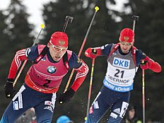 Second placed Anton Shipulin of Russia, left, skis in front of the third placed Dmitry Malyshko of Russia, right, during the men's 15 kilometers mass start...