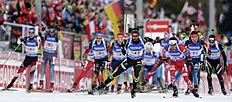 Simon Fourcade of France, center, leads the field after the start for the men's 4x7.5 km relay at the Biathlon World Cup in Ruhpolding, Germany, Thursday,...