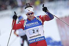 Norway's Emil Hegle Svendsen celebrates as he crosses the finish line to win the men's 4x7.5 km relay at the Biathlon World Cup in Ruhpolding, Germany,...