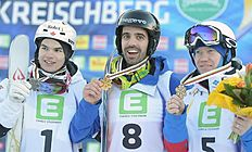 Snowboard (сноуборд): APA21984568-Kreischberg (Austria), 18/01/2015.- (L-R) second placed Mikael Kingsbury of Canada, winner Anthony Benna of france and third placed Alexandr...