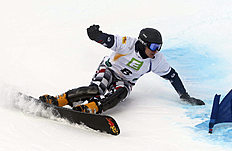 Snowboard (сноуборд): Russia's Andrey Sobolev competes to place second at the men's parallel slalom event at the Freestyle Ski and Snowboard World Championships in Lachtal,...