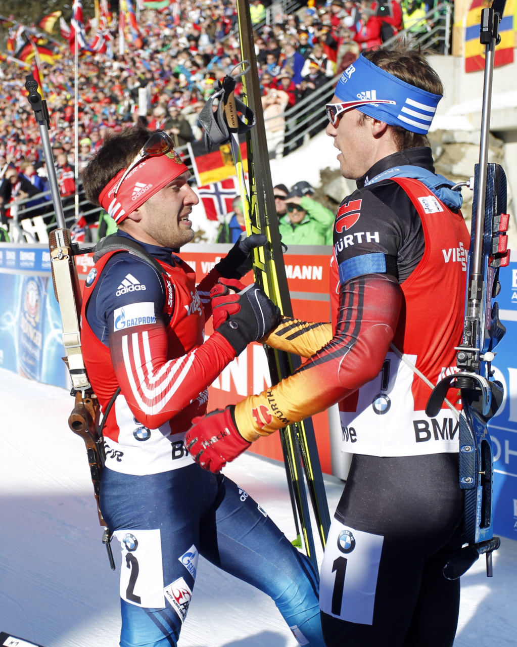 Germany's Simon Schempp, right, is congratulated by Russia фото (photo)