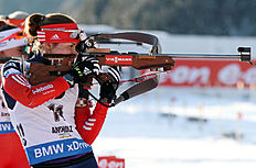 Russia's Daria Virolaynen reloads her rifle during a women's Biathlon 10 kilometer pursuit race in Anterselva, Italy, Saturday, Jan. 24, 2015