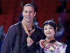 Yuko Kavaguti and Alexander Smirnov, of Russia, show off their gold medals during the awarding ceremony at the European Figure Skating championships in...