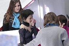 Yuko Kavaguti cries after completing the free program with Alexander Smirnov, of Russia, at the European Figure Skating championships in Stockholm, Sweden,...