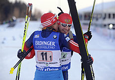 Alexey Volkov, right, and Yana Romanova, left, from Russia celebrate after winning the couple mixed relay, opening race at Biathlon World Cup event in...