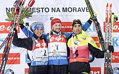 Second placed Simon Schempp from Germany, winner Jakov Fak from Slovenia and third placed Martin Fourcade from France, from left to right, celebrate at...