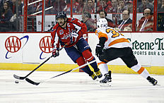 ������ � ������: Washington Capitals left wing Alex Ovechkin (8), from Russia, skates with the puck as Philadelphia Flyers defenseman Mark Streit (32), from Switzerland,...