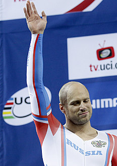 Silver medalist Denis Dmitriev of Russia, celebrates on the podium after the men's sprint race at the Track Cycling World Championships in Saint-Quentin-en-Yvelines,...