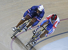 Gregory Bauge of France, left, and Denis Dmitriev of Russia, right, compete during the final of the Men's Sprint at the Track Cycling World Championships...