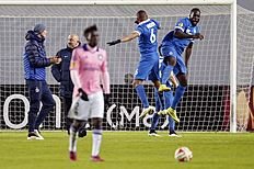 Dinamo's Christopher Samba, right, and William Vainqueur jump as they celebrate after winning the Europa League Round of 32 second leg soccer match between...