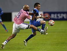 Anderlecht's Anthony Vanden Borre, left, challenges Dinamo's Mathieu Valbuena, during the Europa League Round of 32 second leg soccer match between Dinamo...