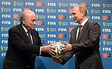 FILE � In this file photo taken on Sunday, July 13, 2014, FIFA President Sepp Blatter, left, and Russian President Vladimir Putin hold a soccer ball during...