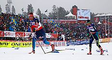 Athletes compete in the men's cross country 50 km mass start classic race during heavy snowfall at the Nordic World Ski Championships in Falun