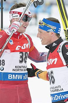 . Kontiolahti (Finland), 07/03/2015.- Tarjei Boe of Norway (L) and Erik Lesser of Germany (R) after the Men's 10 Km Sprint at the IBU World Cup Biathlon...