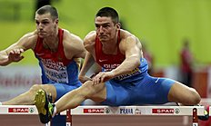 ������ �������� (track and field): Shkurenyov of Russia and compatriot Lukyanenko compete in the men's heptathlon 60 metres hurdles event during the IAAF European Indoor Championships in...