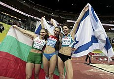 ������ �������� � ������: Winner Koneva of Russia, second placed Petrova of Bulgaria and third placed Knyazyeva of Israel celebrate after their women's triple jump final during...
