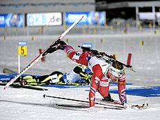Norway's Svendsen falls after shooting during the men's relay competition at the IBU Biathlon World Championships in Kontiolahti