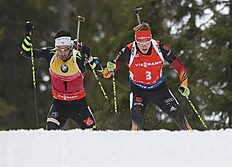Khanty-mansiysk (Russian Federation), 21/03/2015.- Benedikt Doll of Germany (R) and Martin Fourcade of France (L) in action during the men's 12,5...