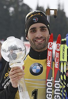 Khanty-mansiysk (Russian Federation), 22/03/2015.- Martin Fourcade of France poses with his trophy for winning the Overall World Cup standing at...