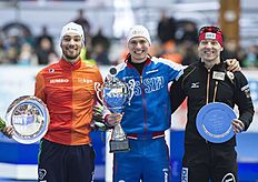 Overall World Cup Winner winner Pavel Kulizhnikov of Russia, center, celebrates besides the second placed Kjeld Nuis of Netherlands, left, and the third...