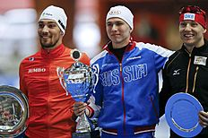 Netherlands' second placed Nuis, Russia's winner Kulizhnikov and Germany's third placed Ihle pose on the podium during a ceremony after the men's 1000m...